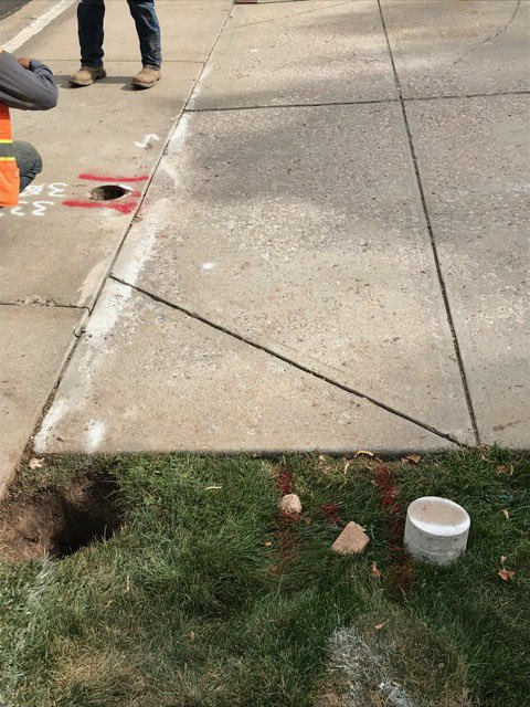 Another view of the dig in before repairs were started. The concrete core in the lower right hand corner is out of the keyhole  over the buried electric line. Source: Fort Collins Utilities