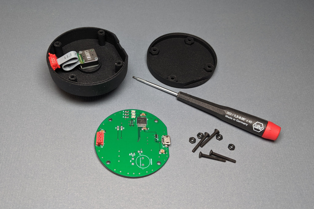 Parts and tools required for assembly. Note how the encoder's ribbon cable is accordion folded into place.