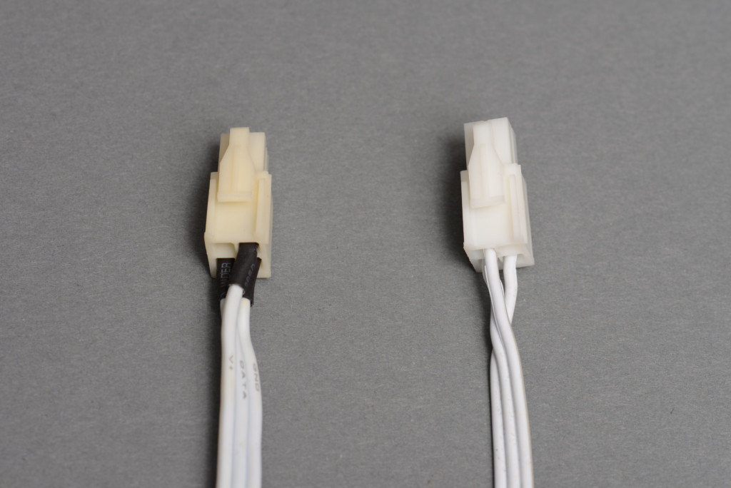 On the left is a string of lights requiring 24 V. On the right is a string of lights requiring 7.5 V. Notice the pin out differences between the two.