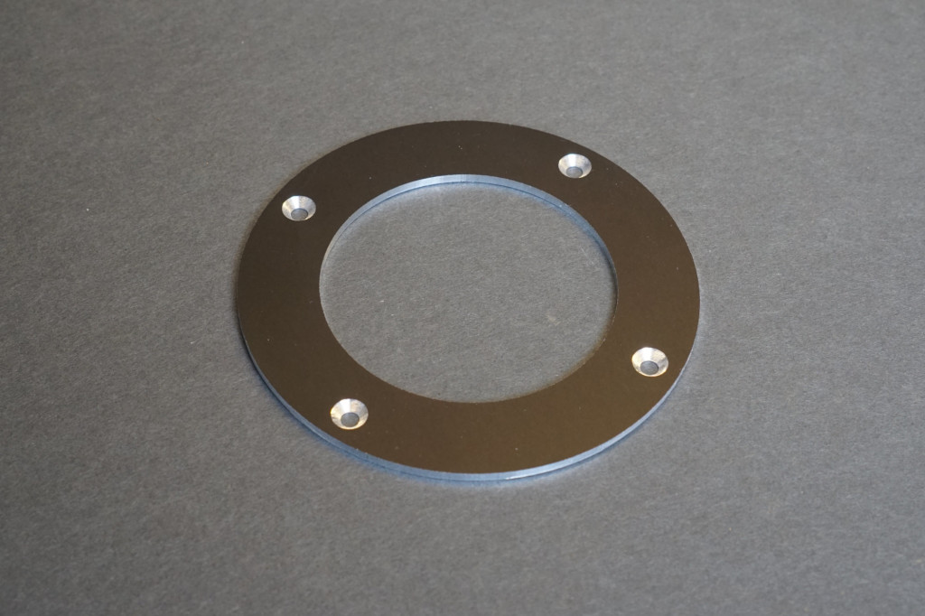 The lid with countersunk screw holes.