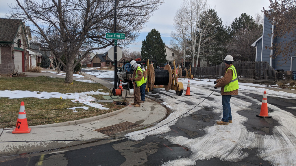 AEG techs pulled fiber in near freezing temperatures while trying not to slip on the remnants of 20 inches of snow! They pulled a 144 fiber cable to here. Now some 96 and 24 fiber cables branching off deeper into the neighborhood. This is one corner away from me.