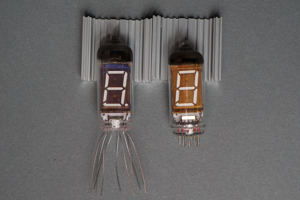 An IV-11 VFD tube from 1989 on the left and an IV-12 VFD tube from 1992 on the right.