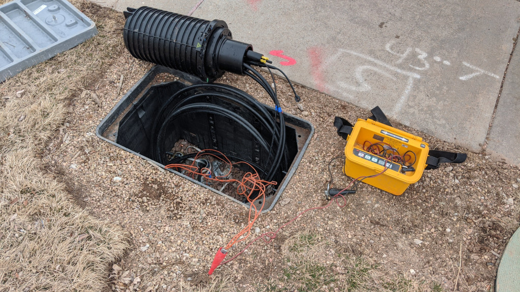 Connecting the locator signal generator to the tracer wires in the conduit.