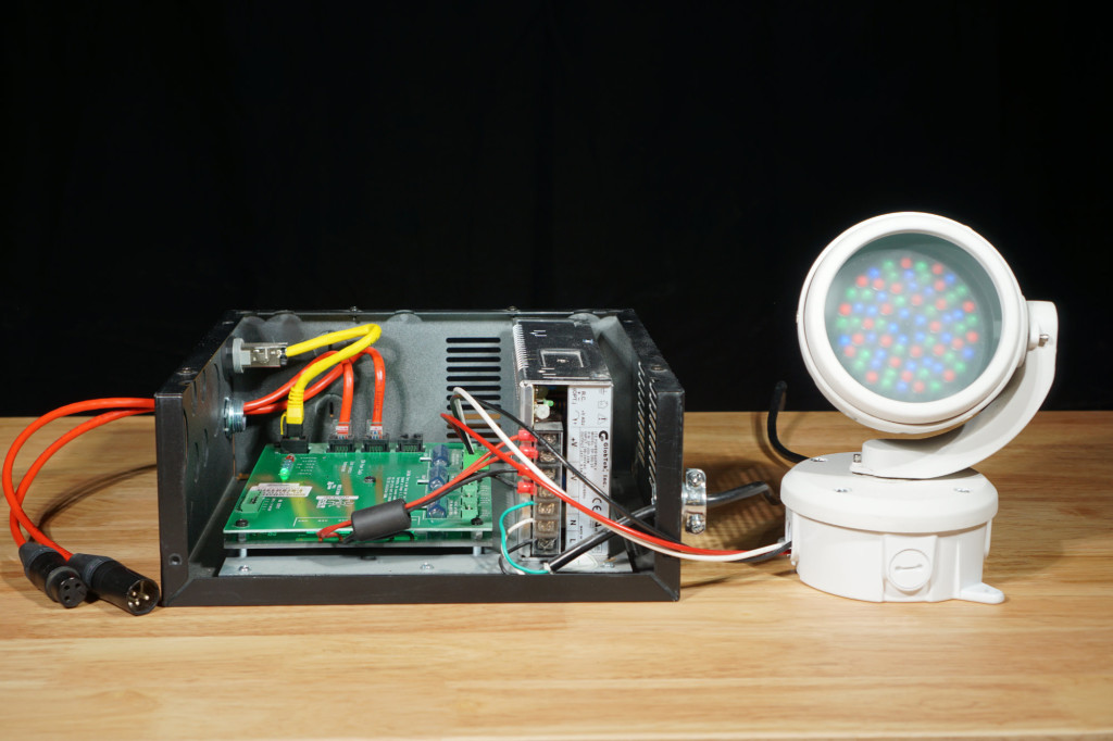 A Color Kinetics PDS-150e power data supply next to a single ColorBurst 4 fixture.