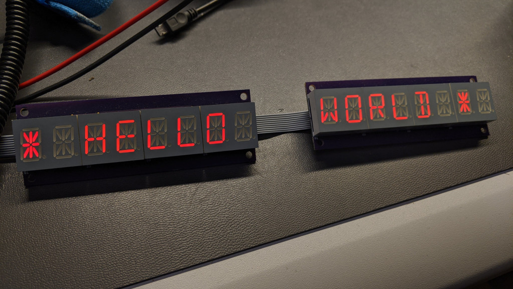 Two daisy chained LED display boards with Kingbright 14-segment red LED displays.