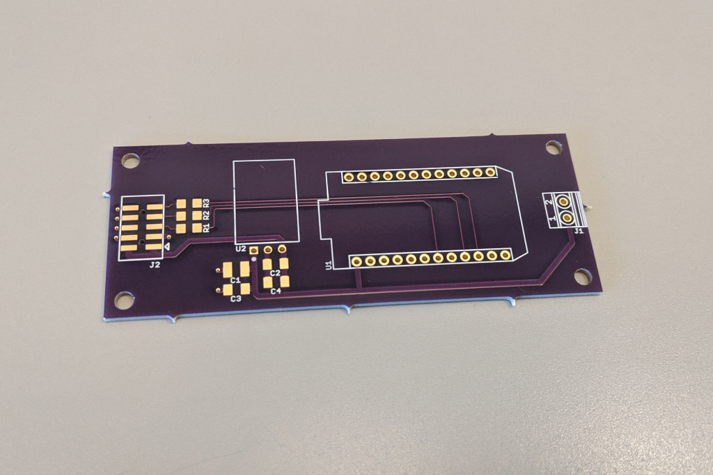 Display controller board housing the 3.3 V power supply and Particle Photon.