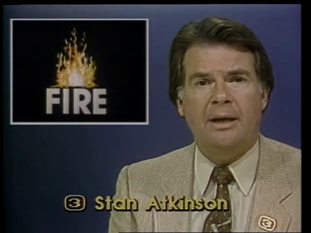 This image consists of three input video sources. The background consisting of the anchor and set, the fire graphic above the anchor's shoulder, and the title graphics with the anchor's name.