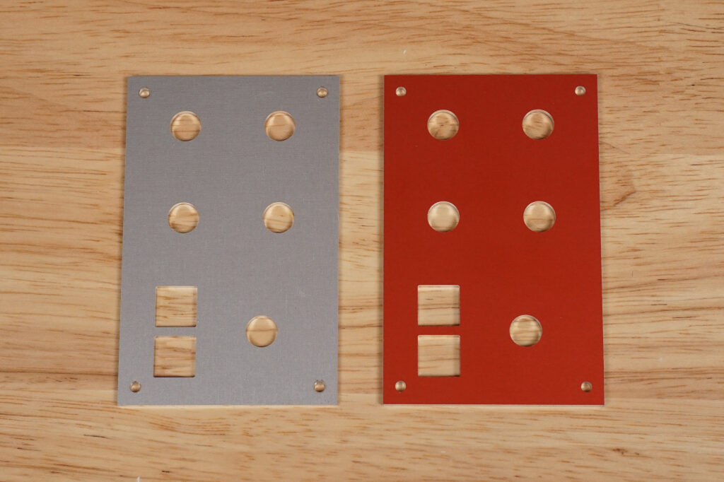 The CNC'ed front panels. I had an extra panel cut out of red anodized aluminum.