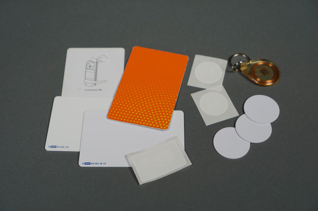 Some example 13.56 MHz RFID cards, stickers, key fobs, and tokens.