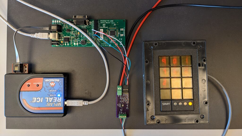 The prototype hardware including a small board to test the design of an electrical interface to the Scramblepad.