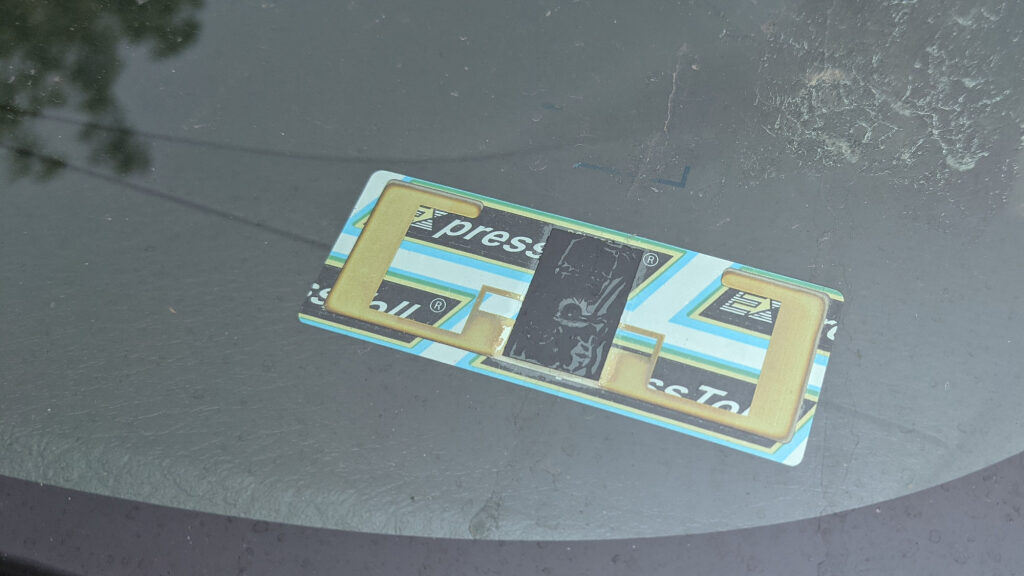 A UHF RFID toll transponder stuck to the inside of my windshield for Colorado's E-470 toll road.